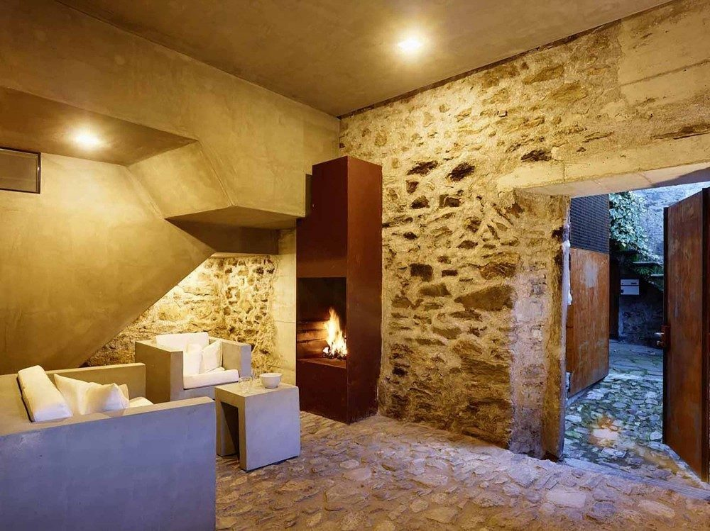 10 espectaculares ejemplos de c mo mezclar edificios - Casas espectaculares en espana ...