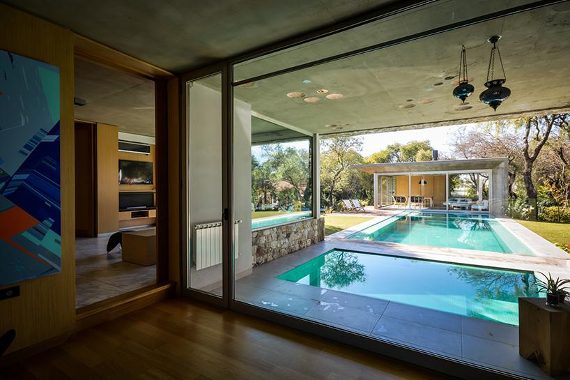 Casas de ensue o una villa de dise o con el sal n a un for Casas con piscina dentro