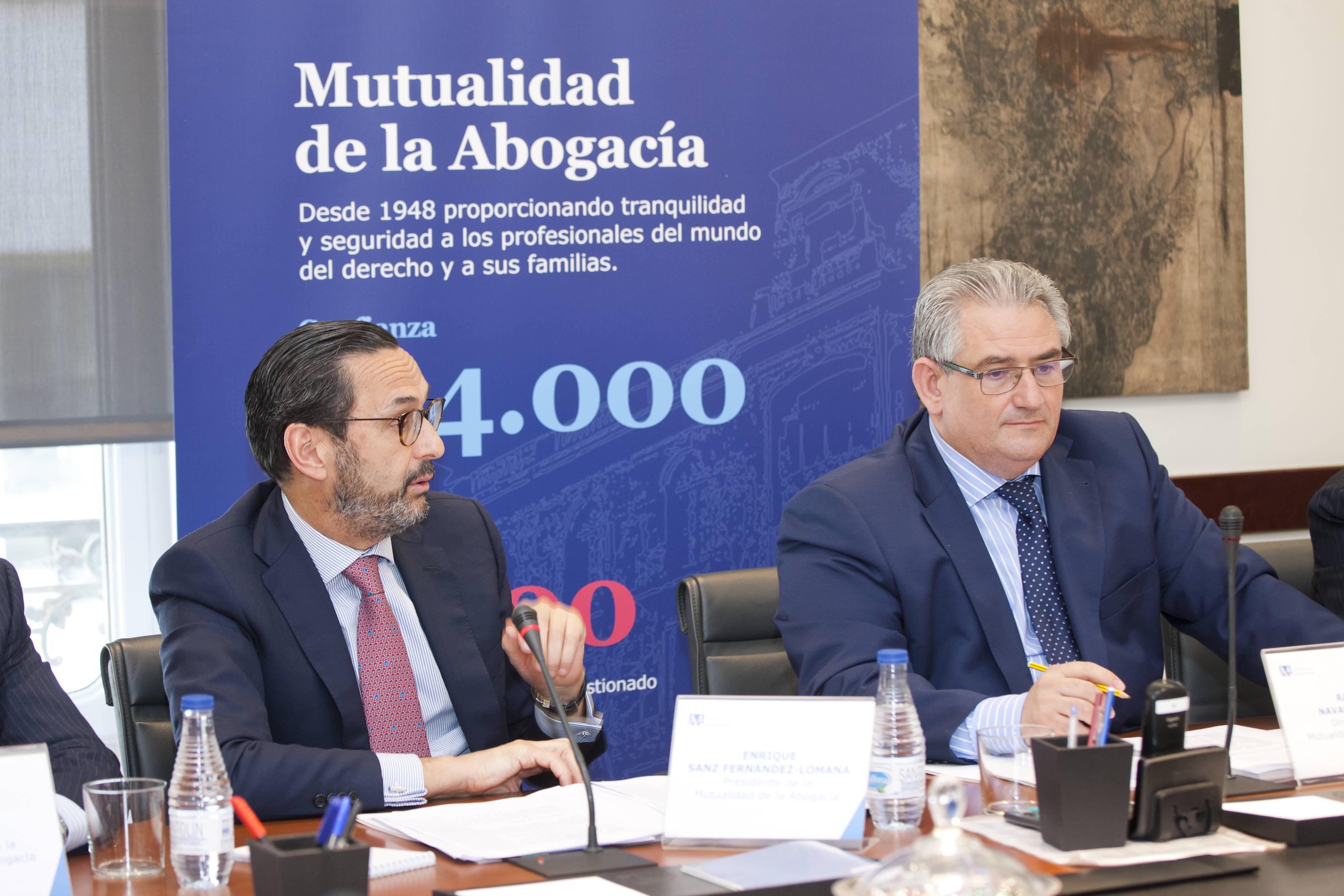 A la izda., el presidente de la Mutualidad, Enrique Sanz Fernández-Lomana