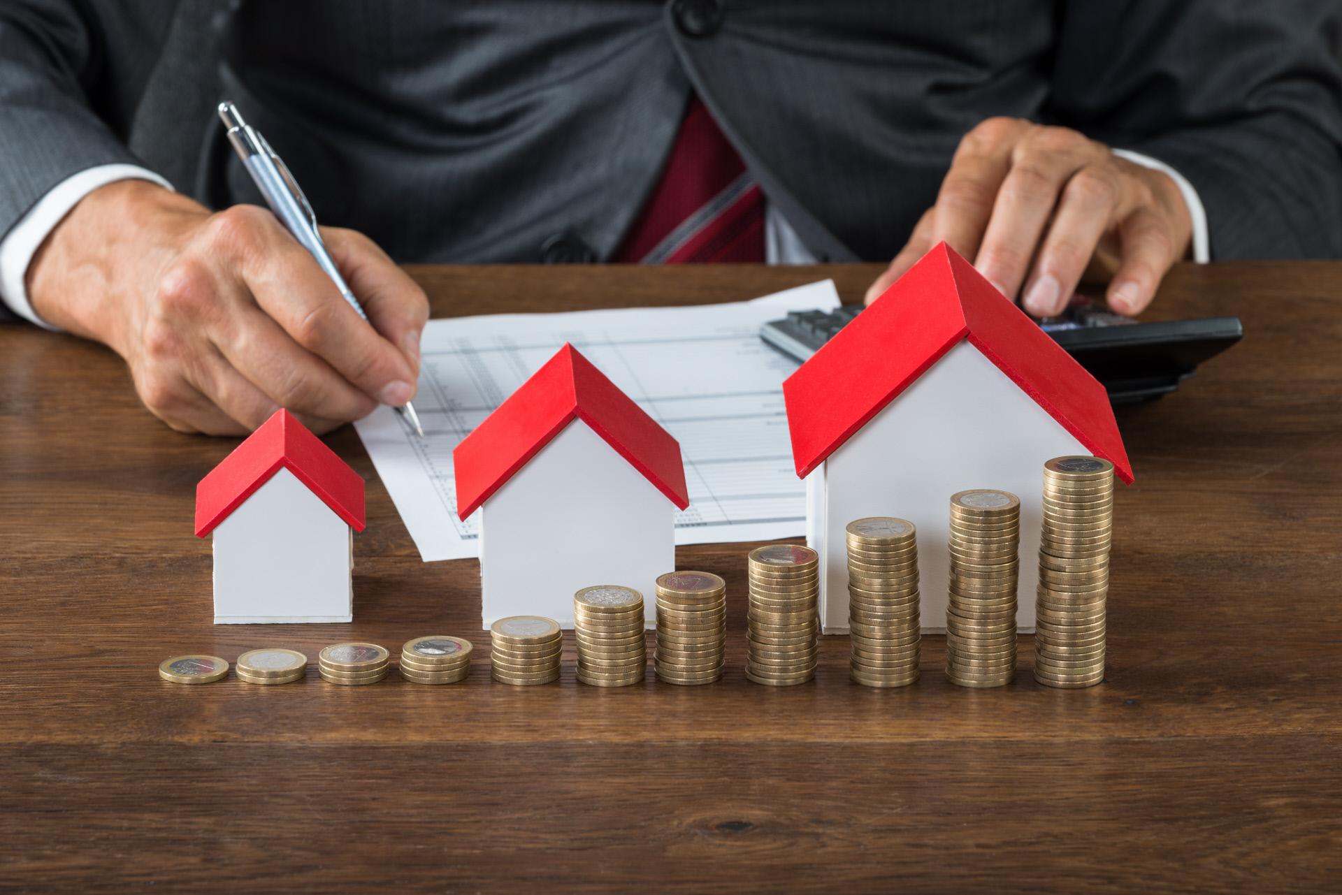 Impuestos a pagar por comprar o vender casa
