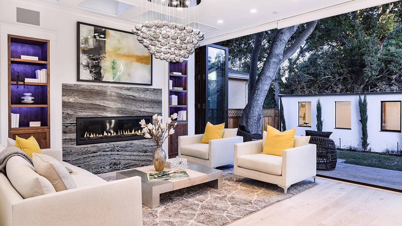 Salón abierto a la terraza / Mindframe LLC