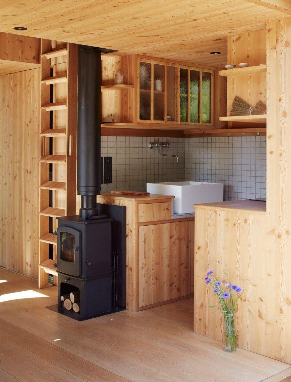 Bonita cocina de madera / Jérémie Léon