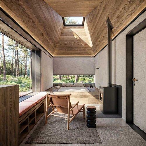 Un espacio abierto con chimenea y tragaluz