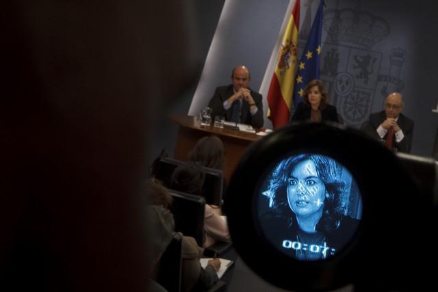 cristóbal montoro, ministro de hacienda, y Soraya Sáenz de Santamaría, vicepresidenta